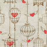 Seamless pattern with birds cage and hearts Stock Photos