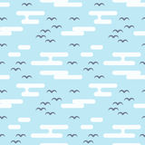 Seamless pattern with birds and clouds. Flat style. Royalty Free Stock Photos