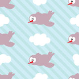 Seamless pattern with birds in clouds on striped background. Royalty Free Stock Photos