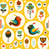 Seamless pattern with birds and flowers on yellow background. Stock Photo