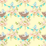 Seamless pattern with birds, nests and eggs on the garlands of the blue flags on spring magnolia tree branches. Hand drawn on a light yellow background Royalty Free Stock Image