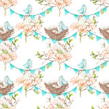 Seamless pattern with birds, nests and eggs on the garlands of the blue flags. On spring magnolia tree branches, hand drawn on a white background Stock Photos