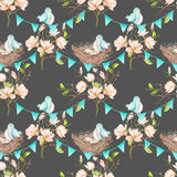 Seamless pattern with birds, nests and eggs on the garlands of the blue flags on spring magnolia tree branches Stock Photos