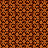 Seamless pattern black background with orange halloween festive, endless pumpkins carved. Vector illustration Royalty Free Stock Photography