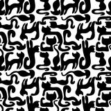 Seamless pattern with black cats Stock Photos