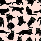 Seamless pattern with black cats in various postures on beige background, hand drawing. Seamless pattern with black cats in various postures on beige background Stock Image