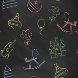 Seamless pattern black chalk board with color children's chalk drawings. Royalty Free Stock Photography