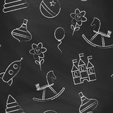 Seamless pattern black chalk board with white children's chalk drawings. Royalty Free Stock Photography