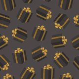 Seamless pattern with black gift boxes. Birthday present boxes with gold ribbon bow. Royalty Free Stock Image