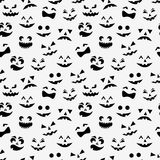 Seamless pattern with black halloween pumpkins carved faces silhouettes on white background. Vector illustration Stock Image