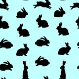 Seamless pattern, black hares silhouette on blue background, Stock Photo