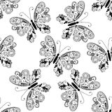 Seamless pattern with black lacy butterflies Stock Image