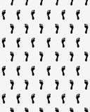 Prints of human feet. Seamless pattern of black silhouettes of prints of human feet Royalty Free Stock Image