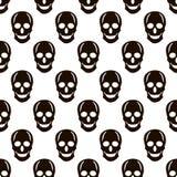 Seamless pattern from the black skulls Stock Photos