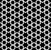 Seamless simple geometric pattern with six-pointed stars and hexagons. Seamless pattern in black and white in average lines.The six-pointed stars and hexagons Royalty Free Illustration