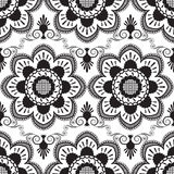 Seamless pattern with black and white mehndi lace of flower buta decoration items on white background. Royalty Free Stock Images