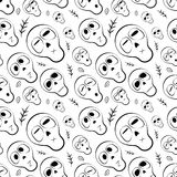 Seamless pattern black and white skulls with herbs Stock Images