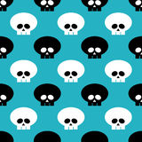 Seamless pattern with black and white skulls over blue. Background Royalty Free Stock Image