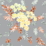 Seamless pattern of blossoming spring branch with yellow flowers and gray and beige leaves on a gray background. Watercolor royalty free stock photography