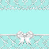 SEAMLESS PATTERN BLUE BACKGROUND DECORATED WITH WHITE LACE AND RIBBONS Royalty Free Stock Photo