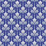 Seamless pattern on a blue background with flowers and leaves. Royalty Free Stock Images