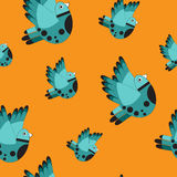 Seamless pattern from blue birds. Vector illustration Stock Photos