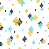 Seamless pattern with blue, black and golden glittering rhombuses. Royalty Free Stock Photos