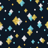 Seamless pattern with blue, black and golden glittering rhombuses. Royalty Free Stock Image