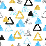 Seamless pattern with blue, black and golden triangles Royalty Free Stock Photo
