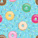 Seamless pattern blue bright tasty vector donuts and sprinkles background in cartoon style for menu in cafe and shop. Seamless pattern blue bright tasty vector Stock Images