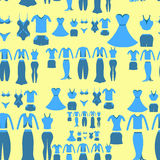 Seamless pattern with a blue clothing female on a yellow backgro Stock Photos