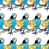 Seamless pattern with blue dancing cheerful Caribbean parrot. ve Stock Photos