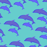 Seamless pattern of blue dolphins Stock Photos