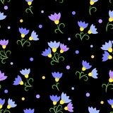 Seamless pattern blue flowers on a black background. Blue flowers on a black background. Seamless Pattern Stock Photography