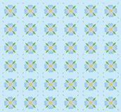 A pattern of blue flowers. A seamless pattern of blue flowers on a blue background Stock Photos