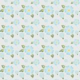 Seamless pattern with blue flowers, green leaves and dotted lines in subdued tone of colour Royalty Free Stock Photography