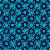 Seamless pattern from blue flowers. Seamless pattern from light blue abstract plants and flowers on a darkv blue  background (can be repeated and scaled in any Stock Images