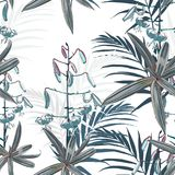 Seamless pattern, blue lilies flowers and green exotic plants on bright background. Blue tones Stock Photos