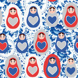 Seamless pattern blue red gray Russian dolls on a floral background.  Stock Image