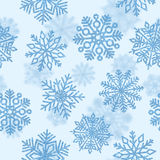 Seamless pattern with blue shiny snowflakes.. Christmas decorati Stock Photo