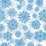 Seamless pattern with blue shiny snowflakes. Christmas decoration of sequin confetti. Glitter powder sparkling background Royalty Free Stock Image
