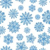 Seamless pattern with blue shiny snowflakes. Christmas decoration of sequin confetti. Glitter powder sparkling background Royalty Free Stock Photography