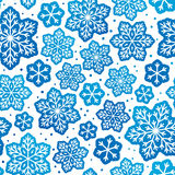 Seamless pattern with blue snowflakes. Ornate Royalty Free Stock Images