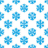 Seamless pattern of blue snowflakes Stock Photography