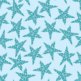Seamless pattern of blue stars against a light background Royalty Free Stock Photography
