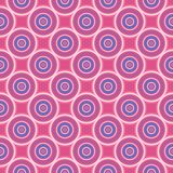 Seamless pattern with blue and white circles on pink background. Stock Photos