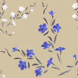 Seamless pattern blue and white flowers on a send color background Royalty Free Stock Photo