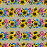 Seamless pattern with blue yellow and pink flowers Royalty Free Stock Images