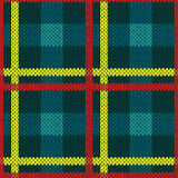Seamless pattern in blue, yellow and red colors. Seamless vector pattern as a woollen Celtic tartan plaid or a knitted fabric texture in blue, yellow and red Royalty Free Stock Image