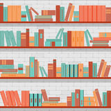 Seamless pattern bookshelves, books on the brick wall background Royalty Free Stock Images